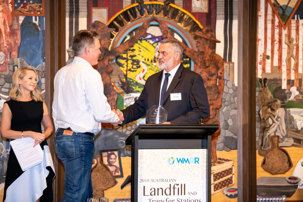 Colin Sweet, CEO of the Australian Landfill Owners Association, presenting Tony Stapleton, CEO of BeneTerra, with the Innovation Award